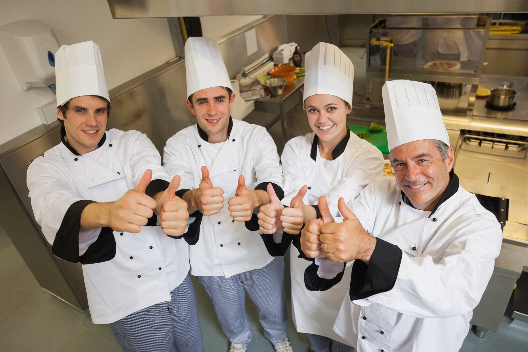 photodune-8450170-team-of-chefs-giving-thumbs-up-in-restaurant-kitchen-m